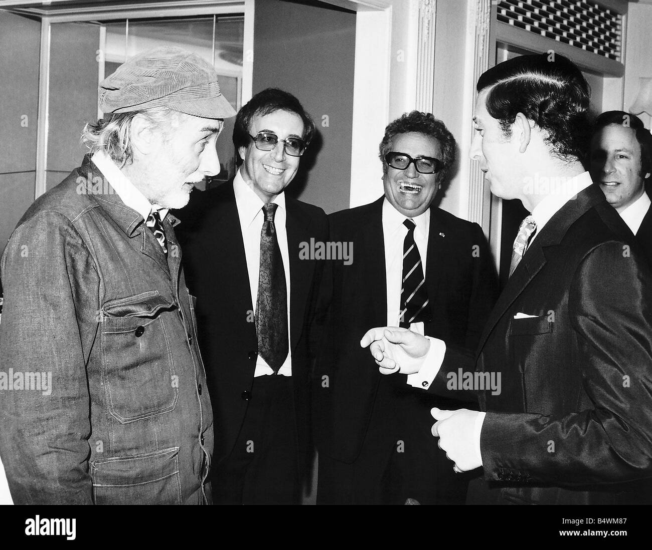 Spike Milligan with fellow Goon members minus Michael Bentine meet Prince Charles at a dinner in London to celebrate - Stock Image