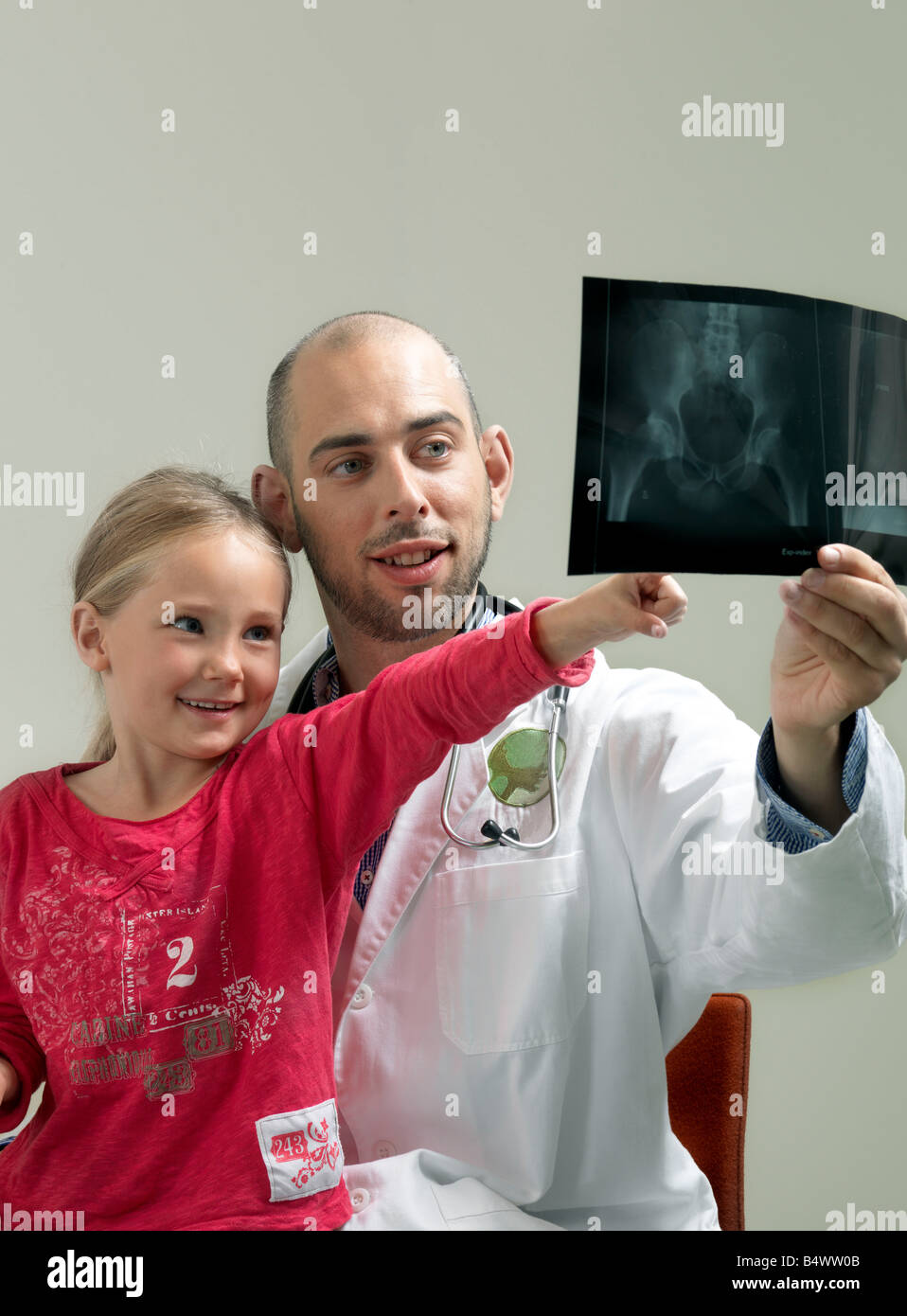 Girl and doctor with x-ray - Stock Image