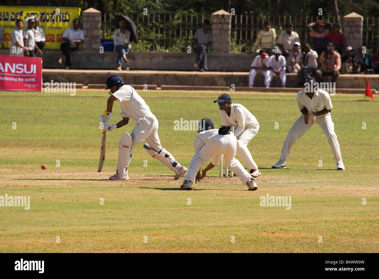 A batsman plays a defensive stroke in First Class Cricket in Mysore, India. Karnataka host Harayana in the Ranji - Stock Image