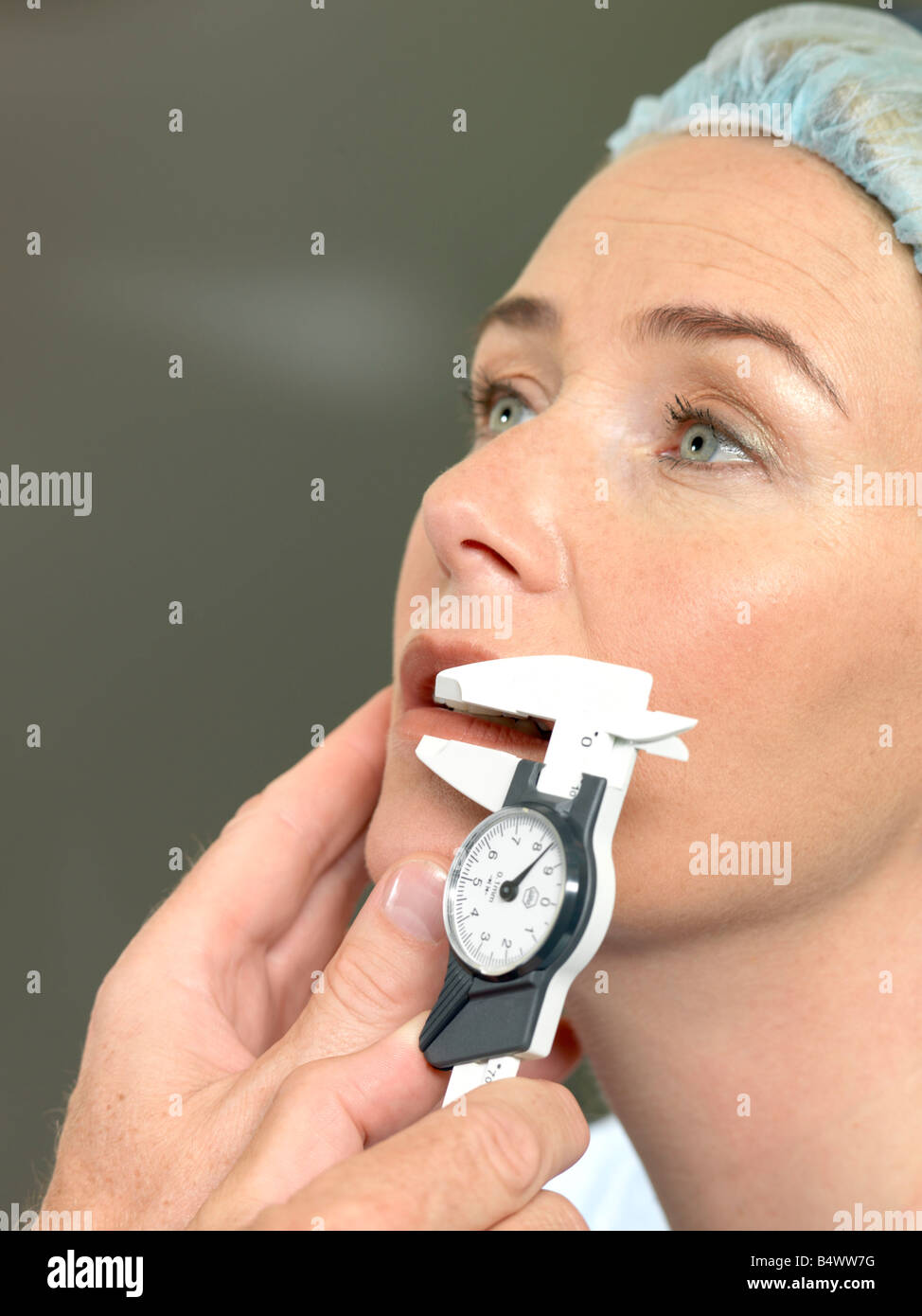 Doctor preparing patient for surgery - Stock Image