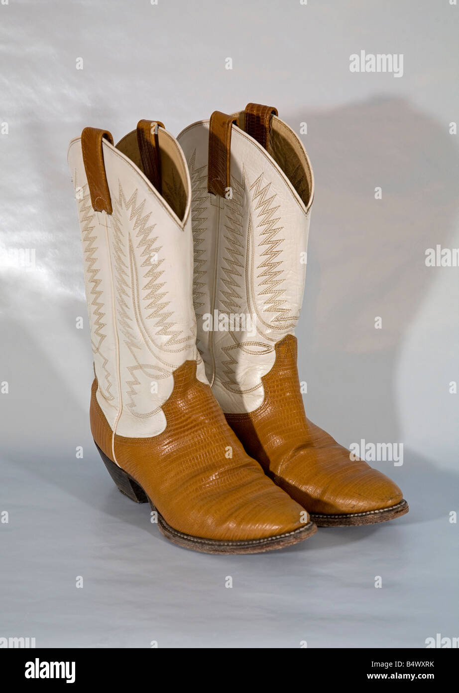 A pair of embroidered high heeled high topped western cowboy boots made in Mexico - Stock Image
