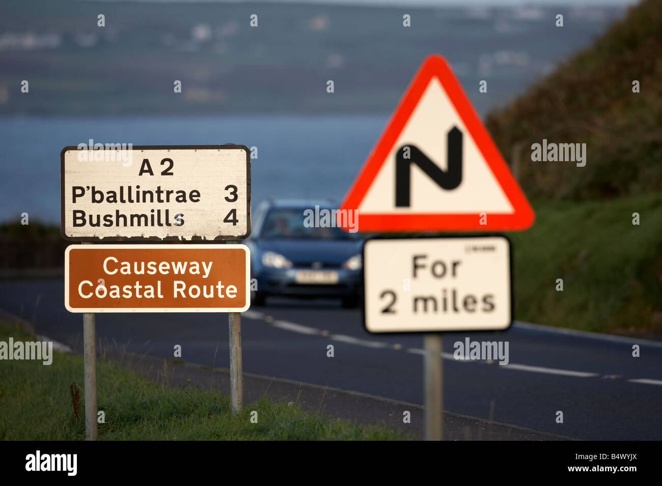 danger red warning triangle for 2 mile sign on the famous A2 north antrim causeway coastal road route county antrim Stock Photo