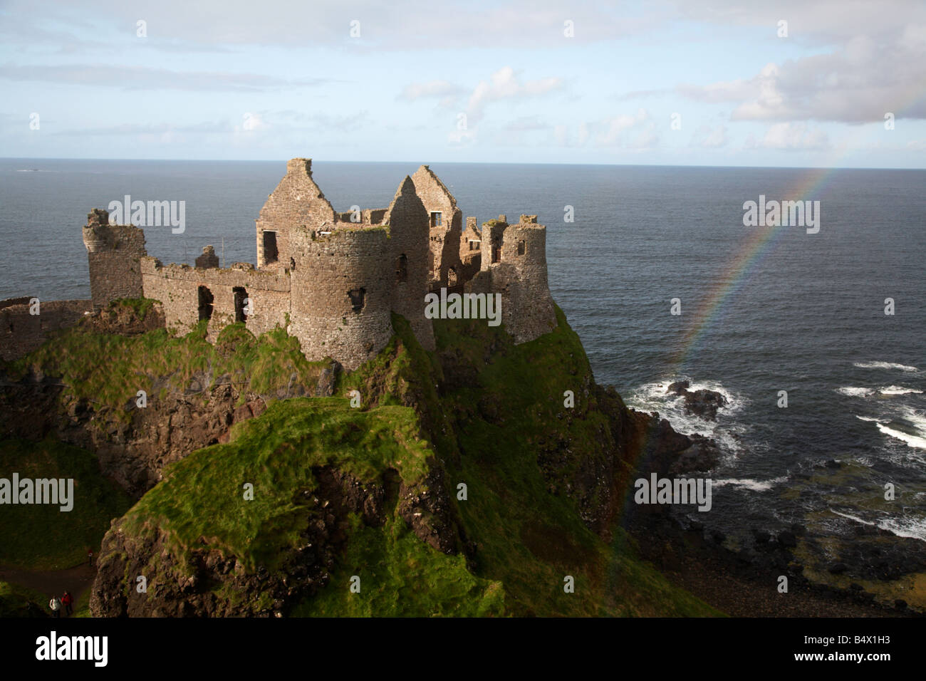 dunluce castle with rainbow and the north antrim coastline county antrim northern ireland uk one the filming locations for game of thrones Stock Photo