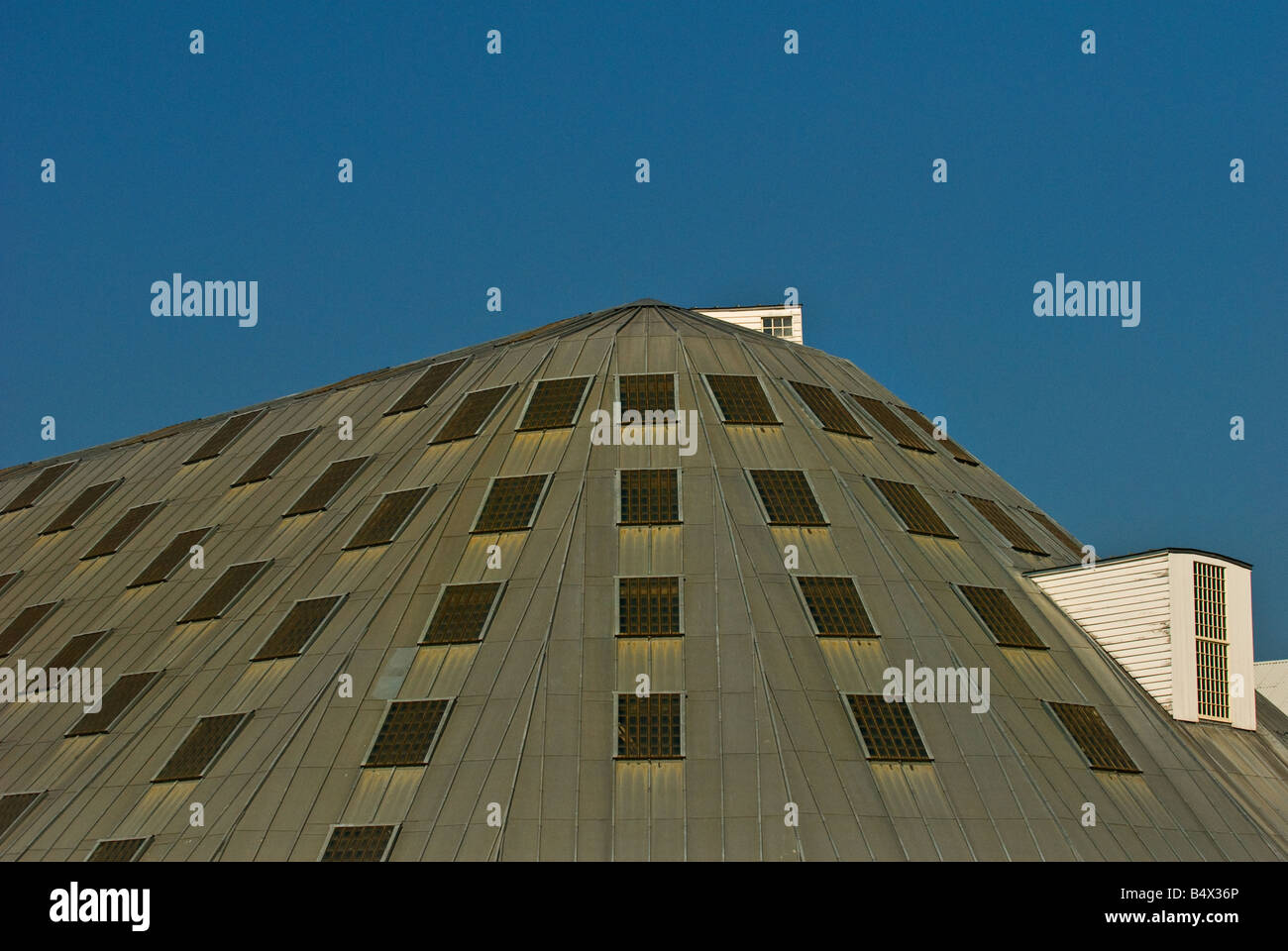 The roof of No 3 Slip Cover Chatham Historic Dockyard in Kent. - Stock Image