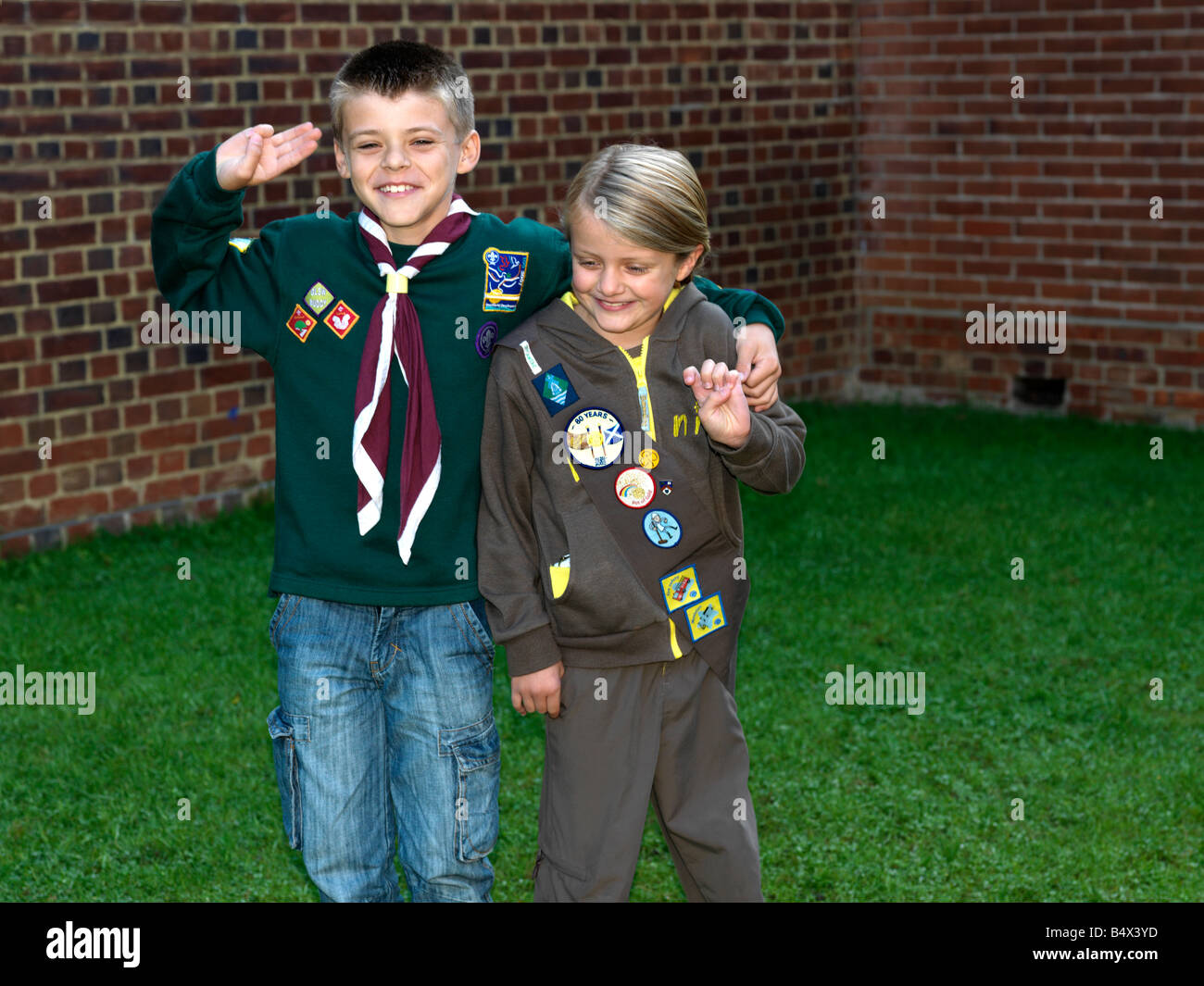 Cub and Brownie with Badges - Stock Image