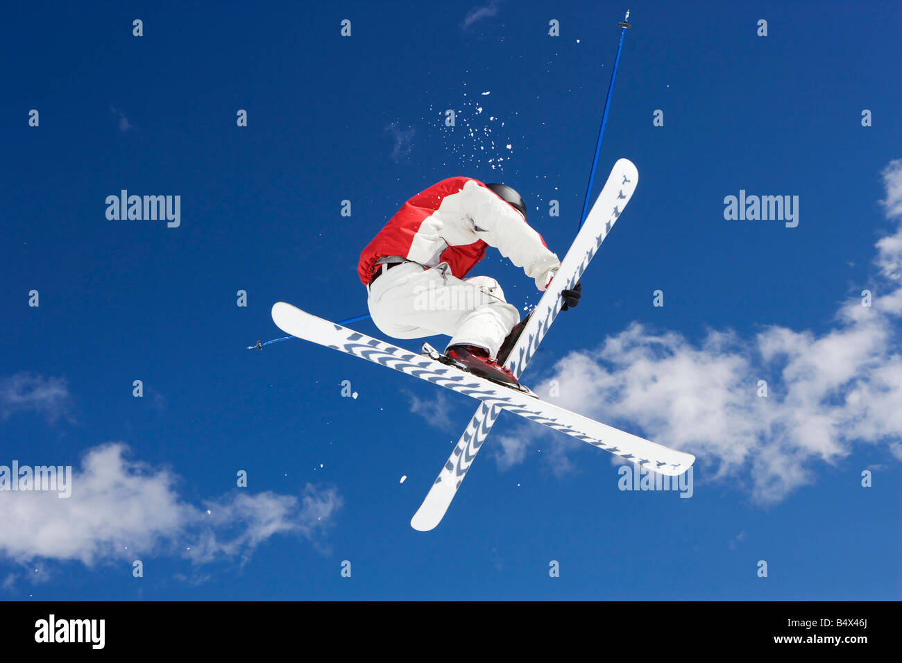 Skier performing jumping trick - Stock Image