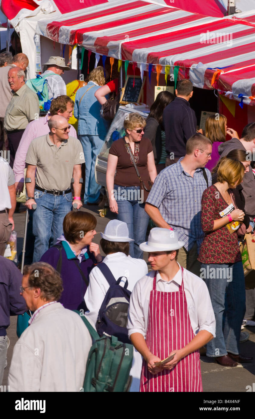 People wander and browse openair stalls at Abergavenny Food Festival - Stock Image