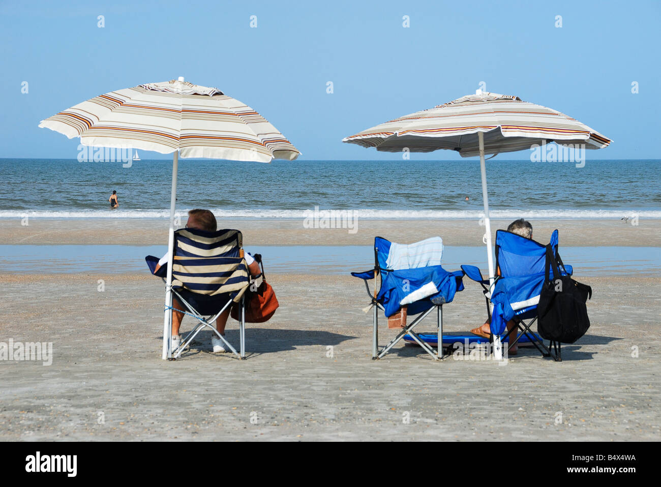 Mature couple relaxing on the beach - Stock Image