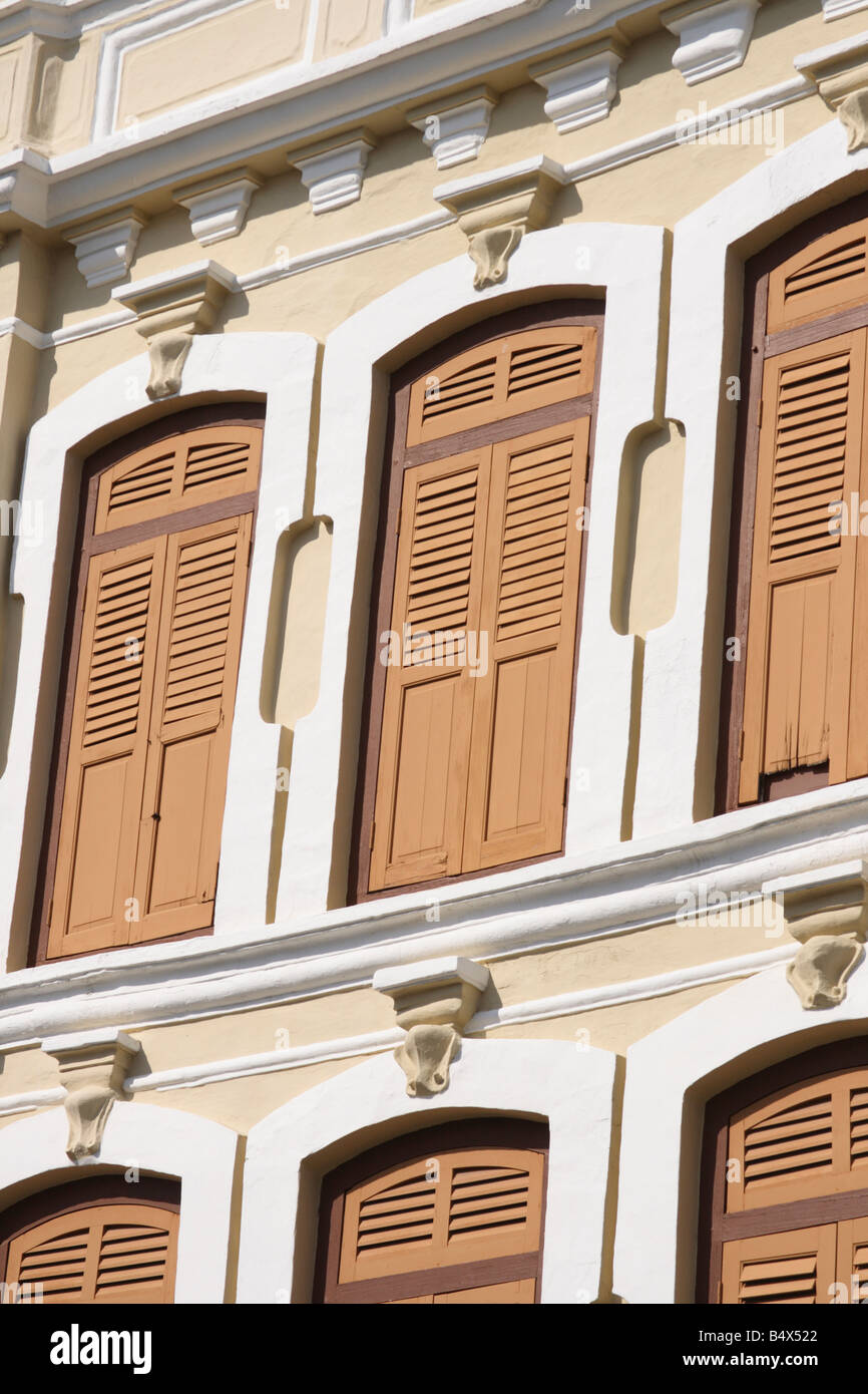 window of old colonial shophouse building in Penang, Malaysia - Stock Image
