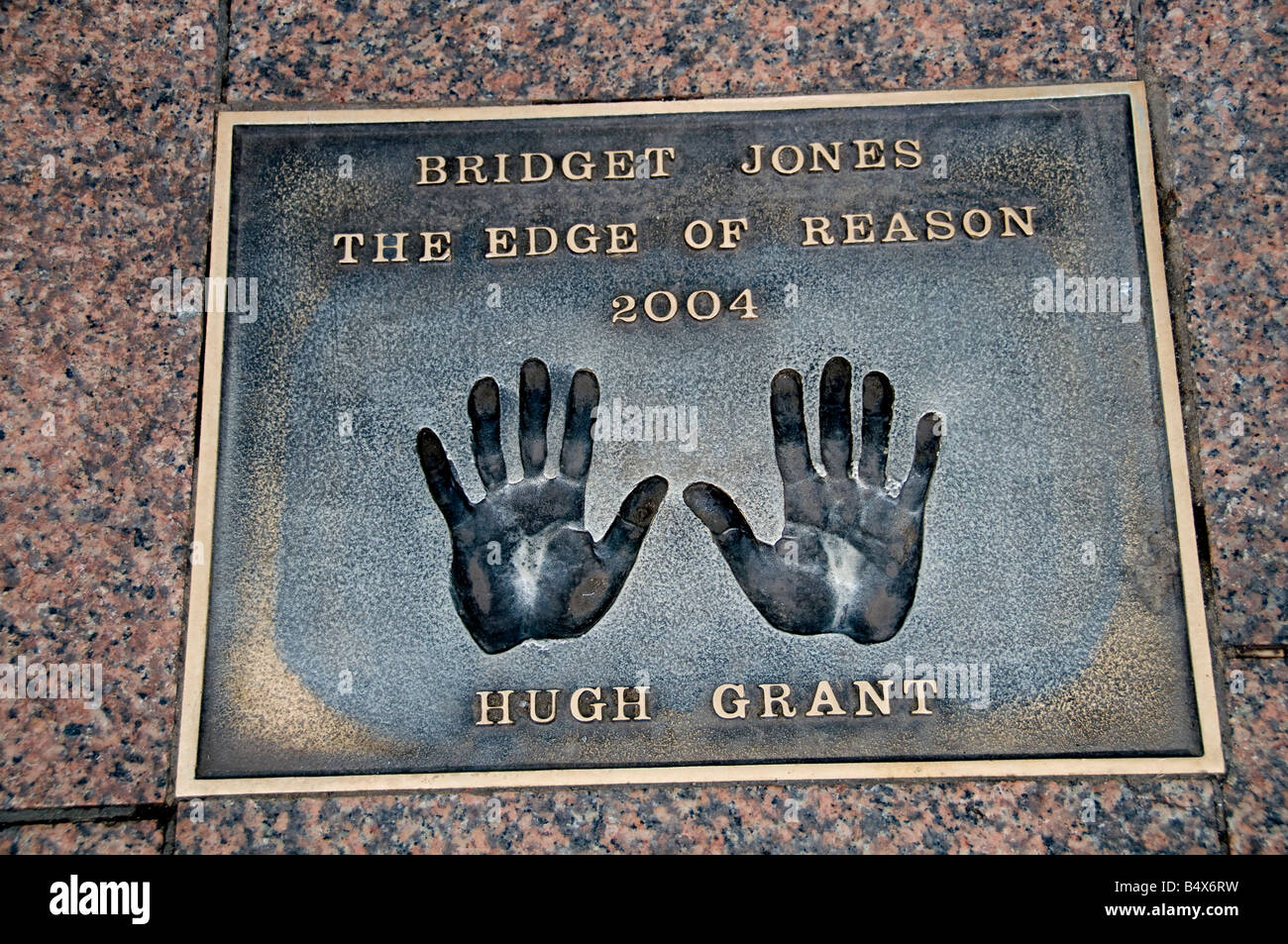 Hugh Grant Hand Foot Prints Paving Chinese Theater in Hollywood Boulevard Los Angeles - Stock Image