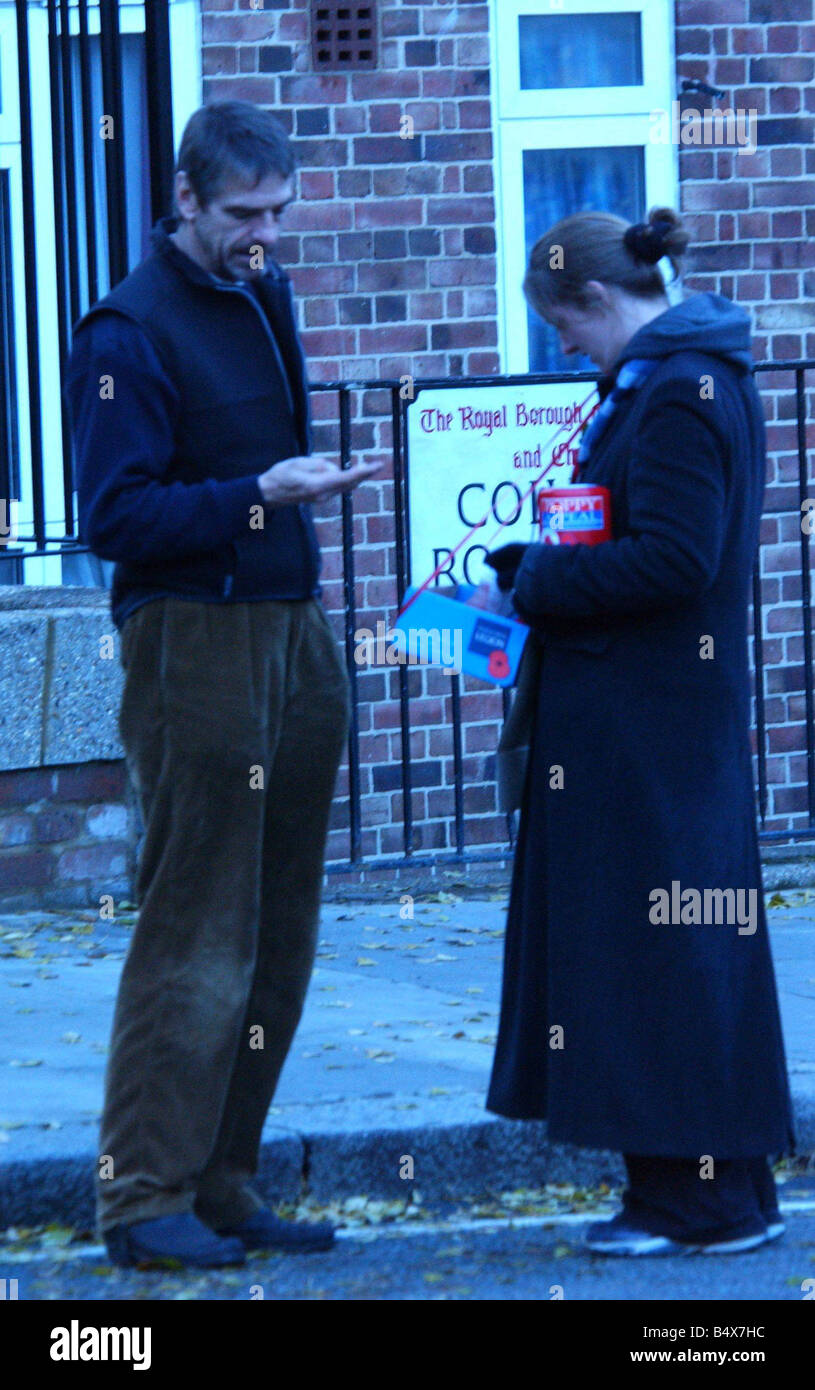 Jeremy Irons buying a poppy in Notting Hill - Stock Image