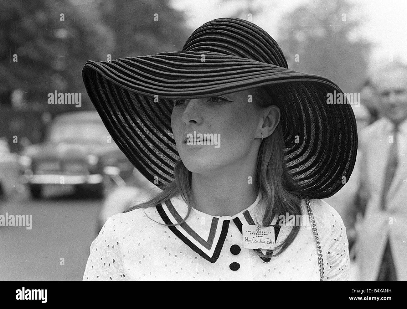 1968 Clothing Ascot Racing Fashion Woman Wearing white dress and floppy straw hat at Ascot Races - Stock Image