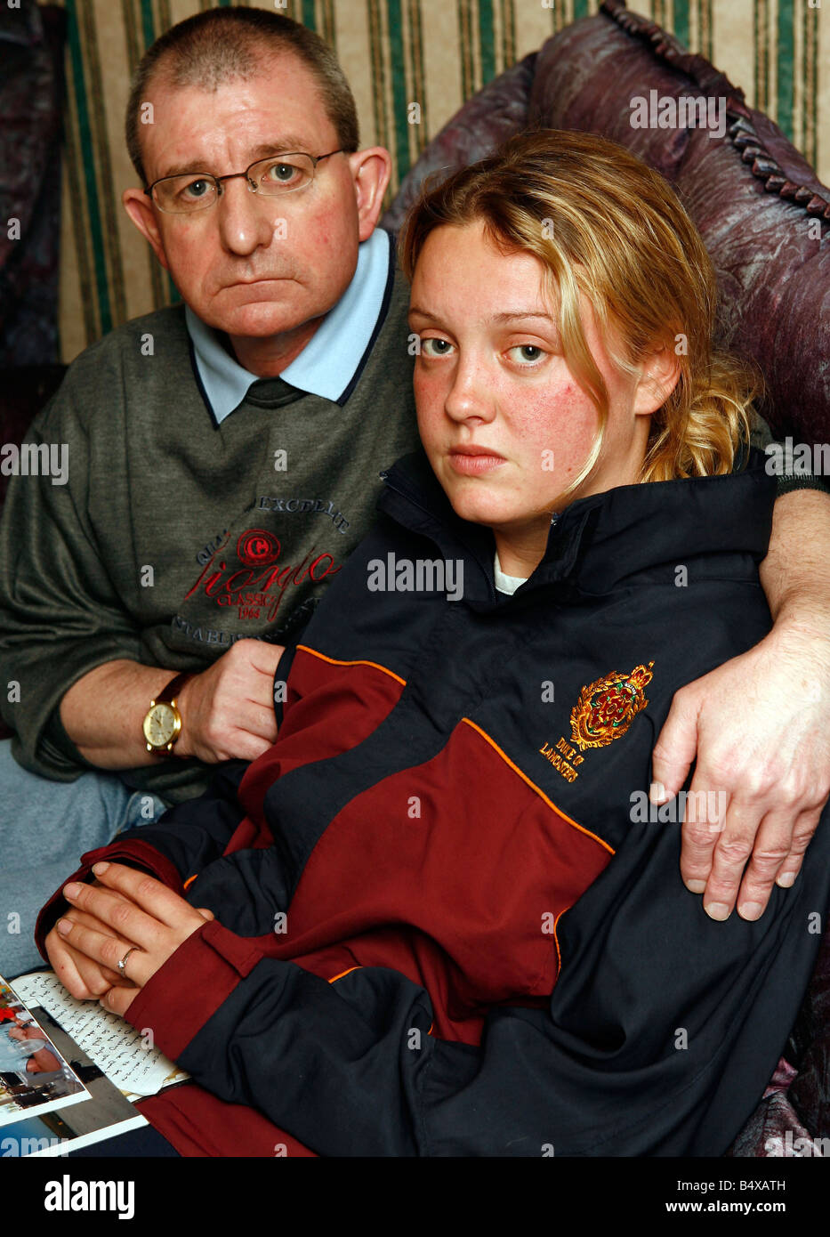 Rebecca Barnes, girlfriend of Graham Hesketh , the latest soldier to be killed in Iraq, with Graham's dad, Kevin - Stock Image