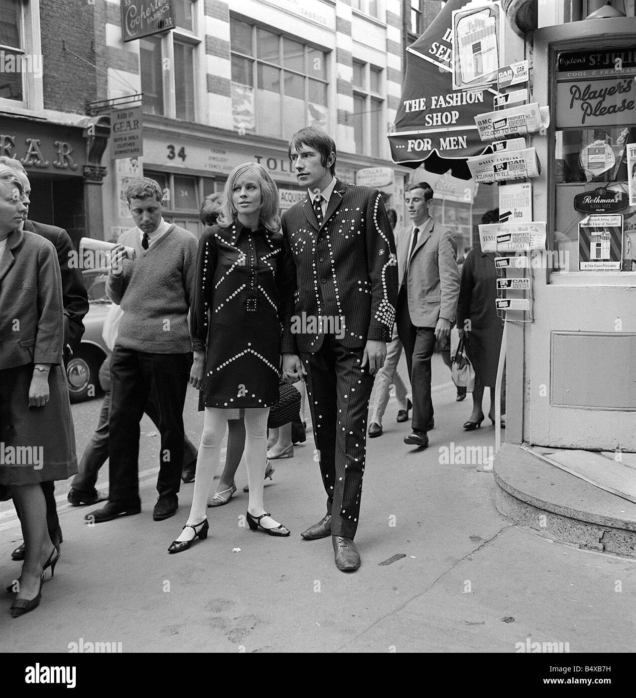 Carnaby Street London was a fashion mecca in the 1960s This image shows how the trendy youths of that time preferred - Stock Image