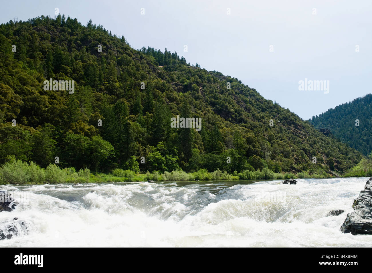 Whitewater raft approaching waterfall - Stock Image