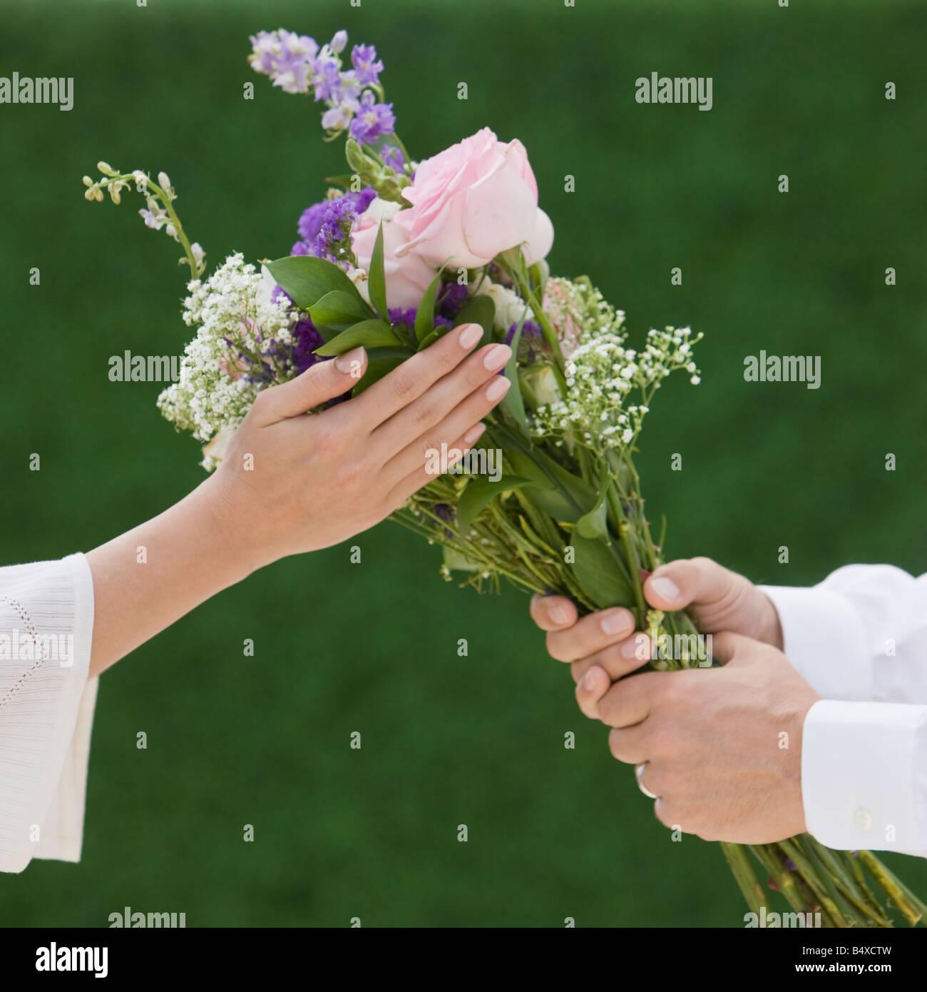 Man giving woman flowers stock photos man giving woman flowers man giving woman bouquet of flowers stock image izmirmasajfo Image collections