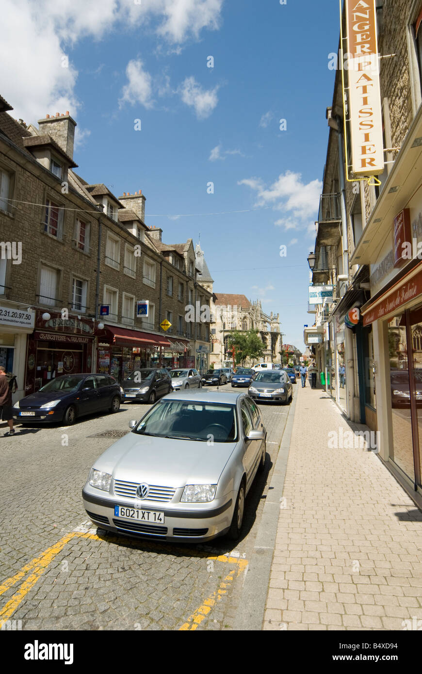 Cars parked in a street in the french town of Falaise Normandy France Stock Photo