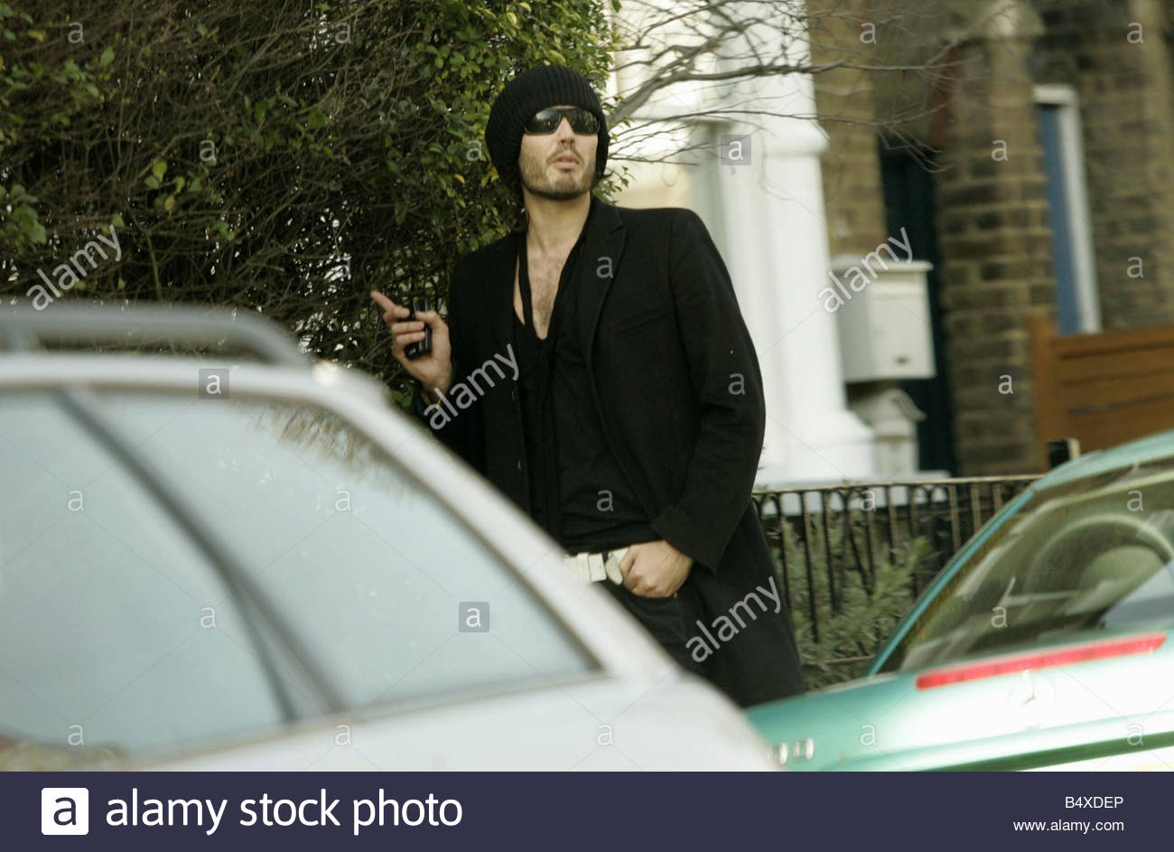 Russell Brand on the morning after the Brit Awards Moments before this picture was taken a mystery woman was snapped Stock Photo