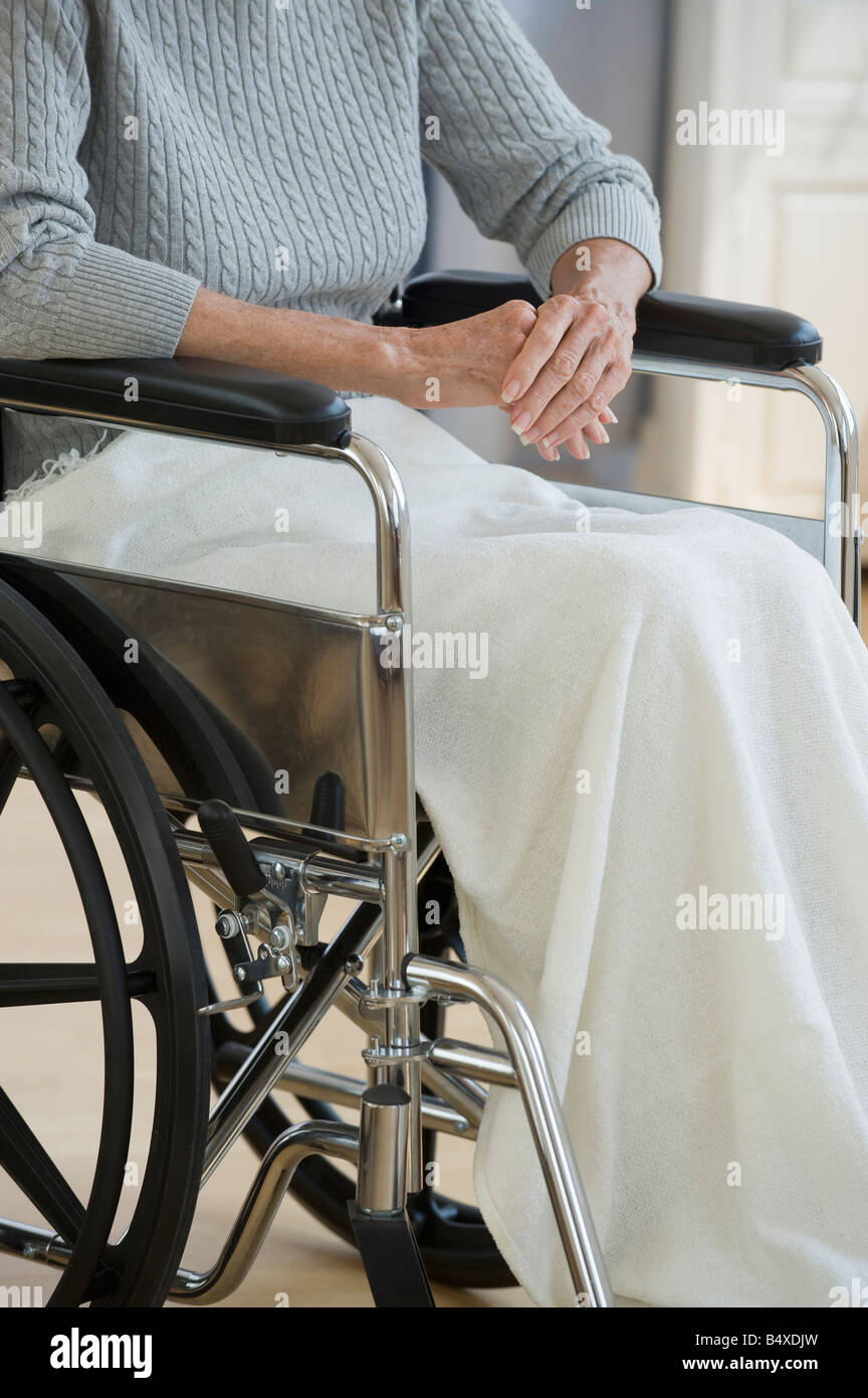 Senior woman sitting in wheelchair - Stock Image