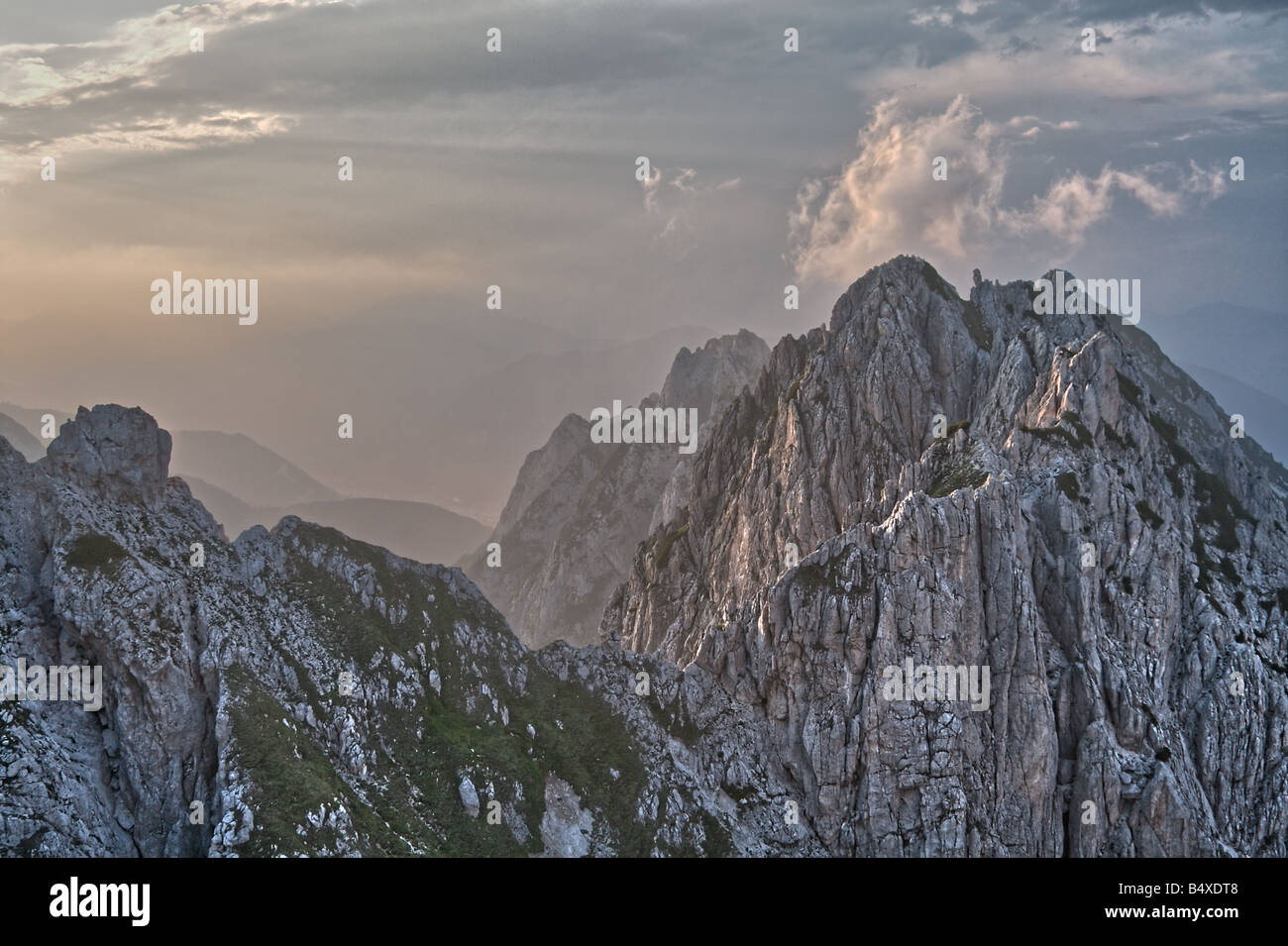 Peaks and mists on the Italian side of the Mangart Pass in the Julian Alps at Sunset - Stock Image