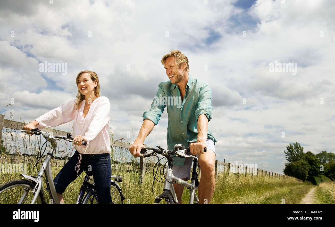 Couple on cycles - Stock Image
