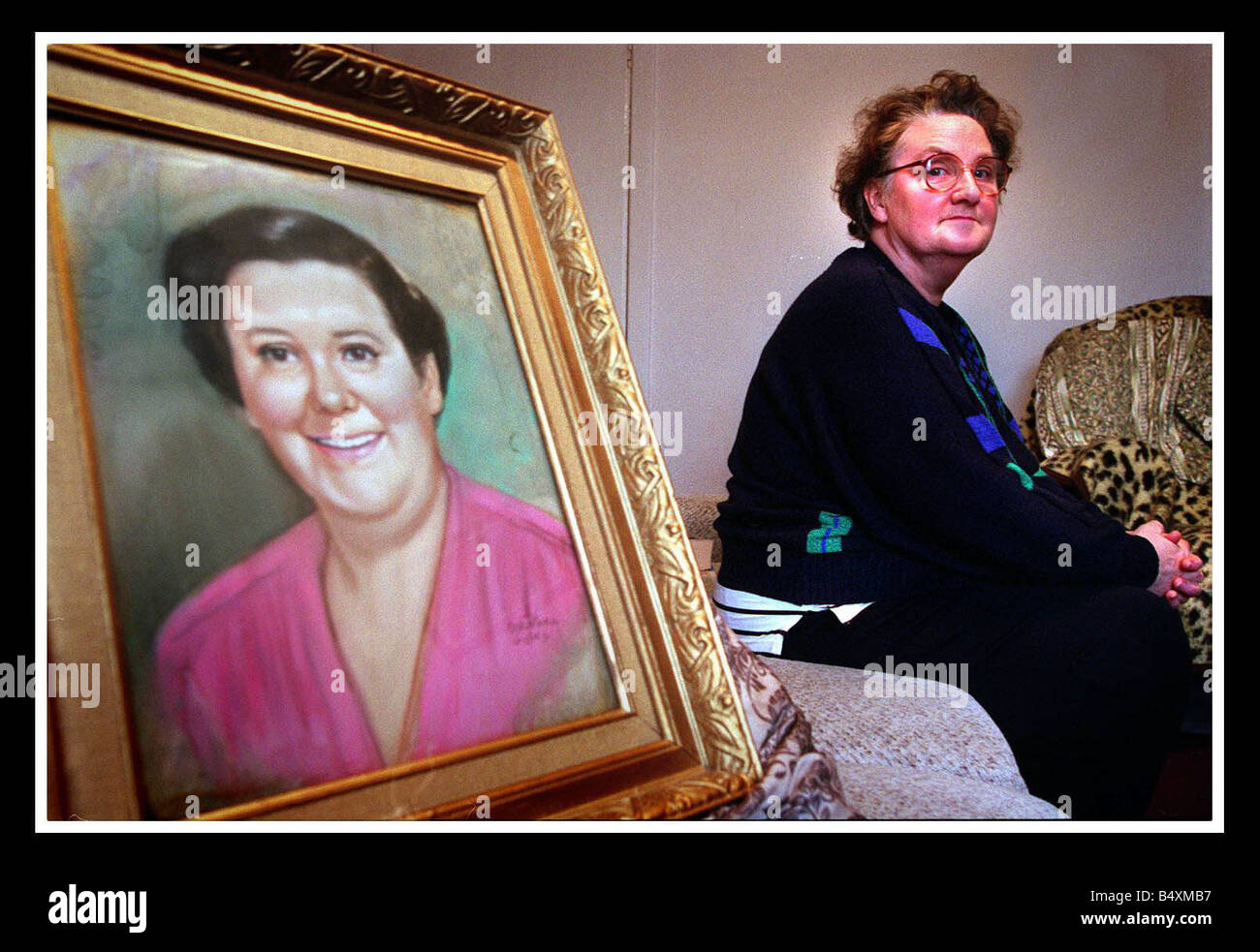 Dawn Dale with the painting of her Grandmother Helen Duncan who was the last woman convicted of witchcraft in Britain - Stock Image