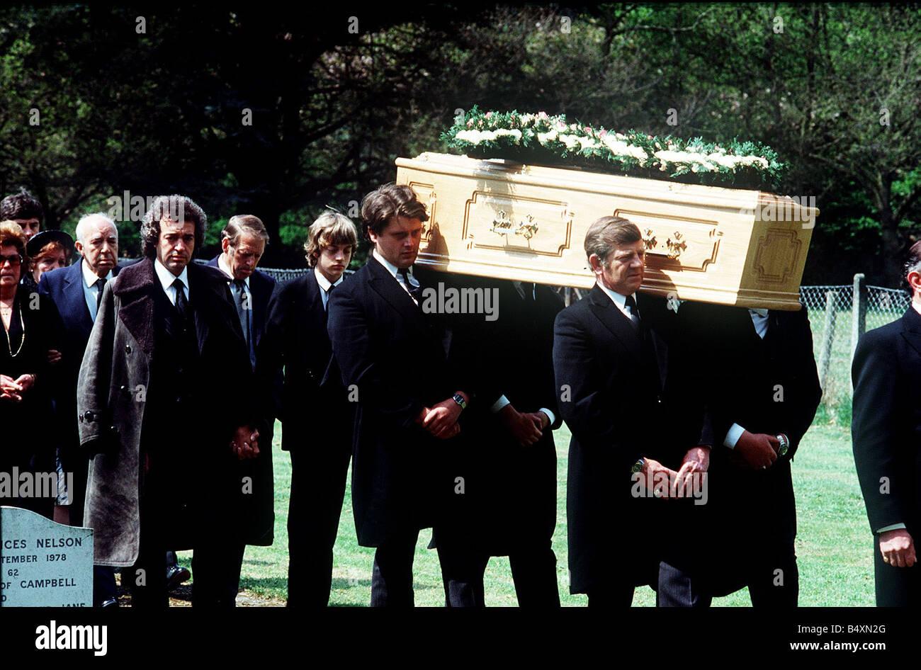 Alan Lake and son Jason follow the coffin of Diana Dors