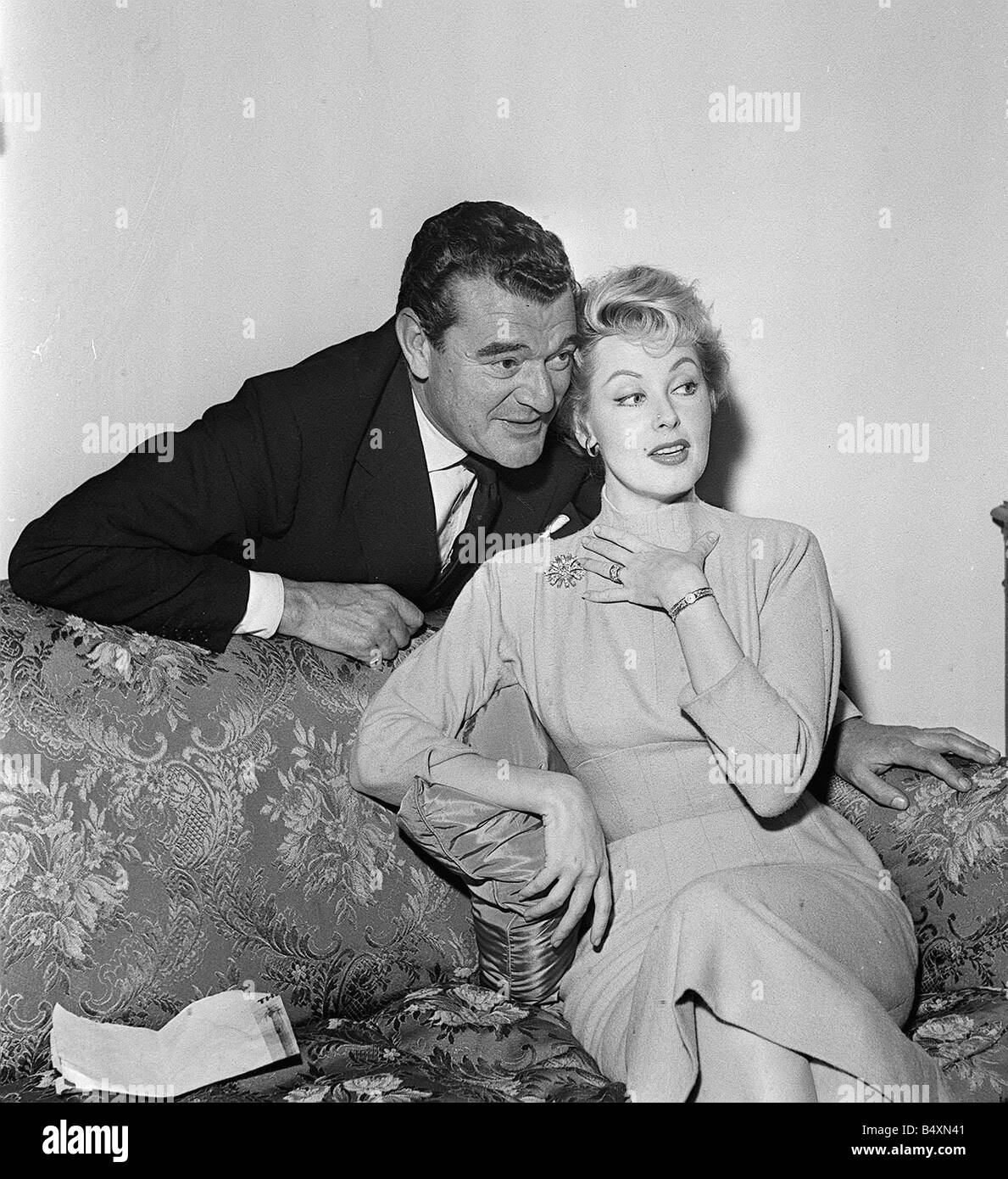 Arlene Dahl and Jack Hawkins who is to star in the film Fortune is a Woman 1956 - Stock Image