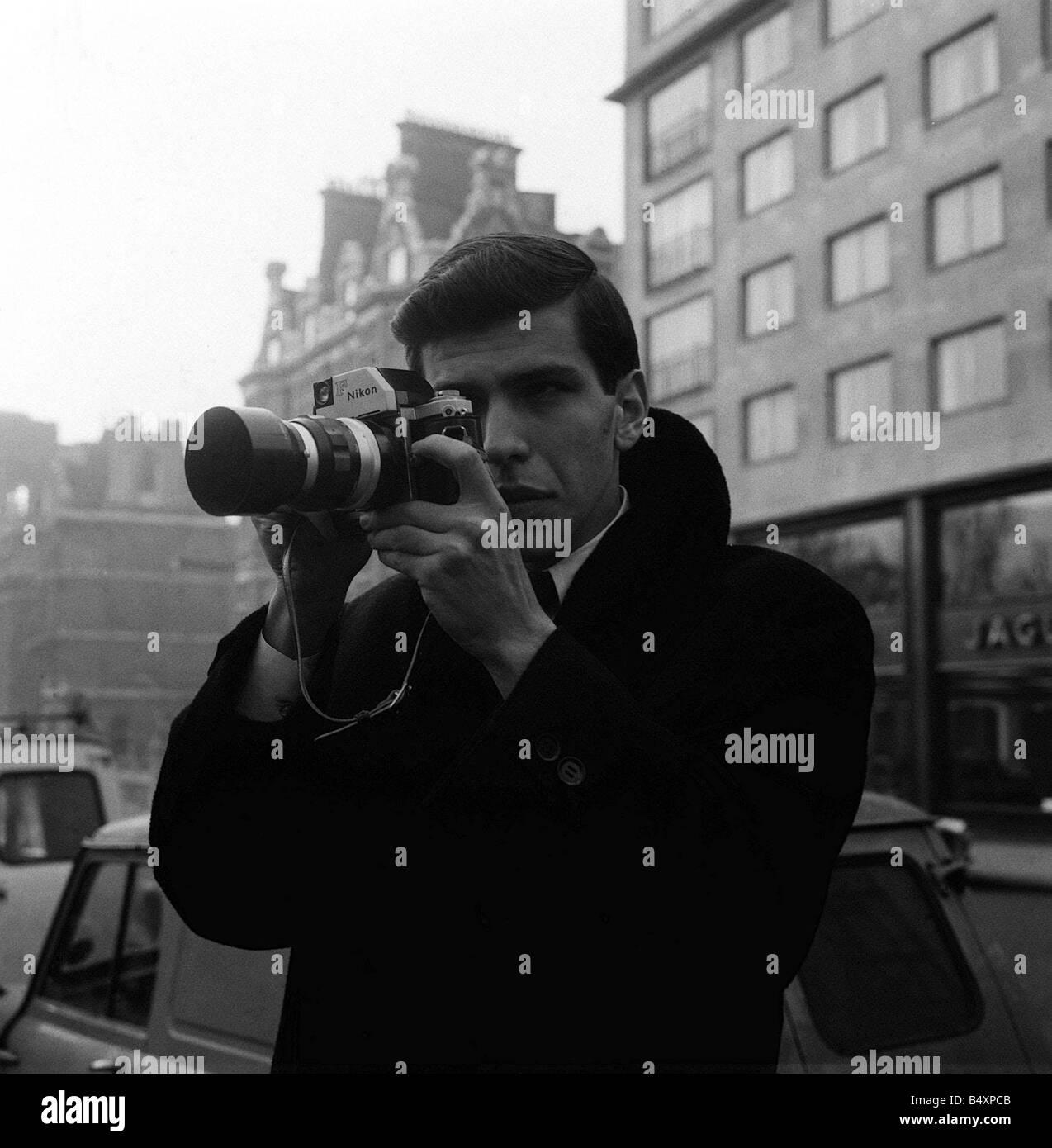 Frank Sinatra Jnr in London January 1964 taking photograph with a Nikon F SLR Camera - Stock Image