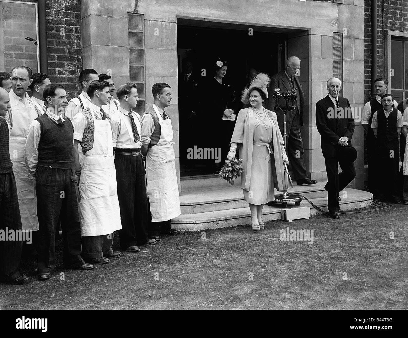 Queen Elizabeth now the Queen Mother leaving the Lord Roberts Memorial Workshop which she opened during visit to - Stock Image