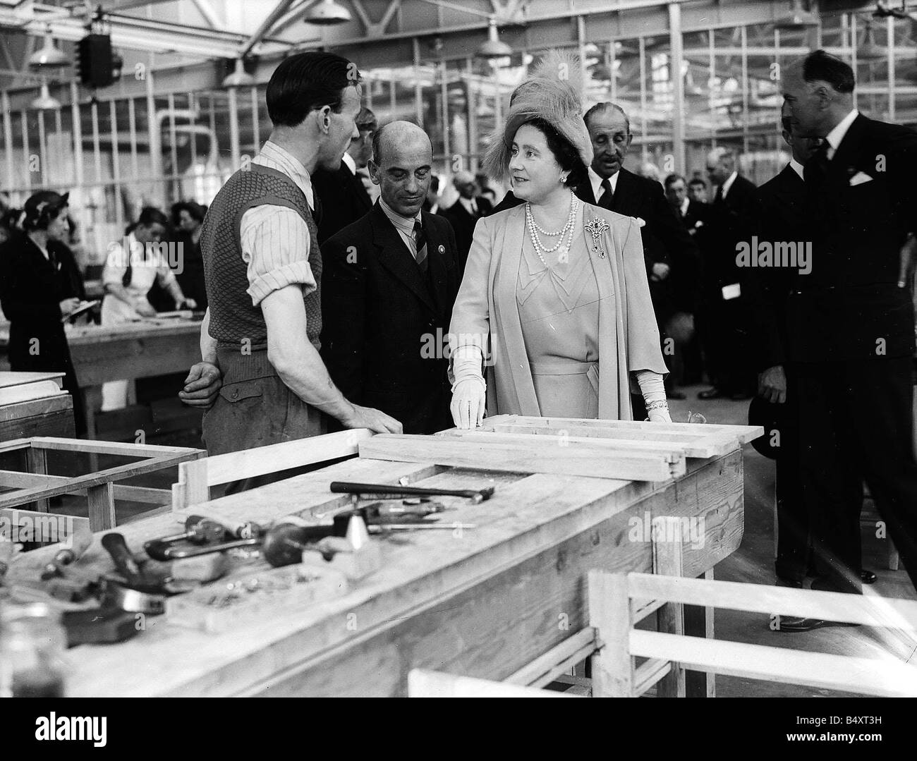 Queen Elizabeth now the Queen Mother talking to a diasabled ex serviceman at the Lord Roberts Memorial Workshop - Stock Image