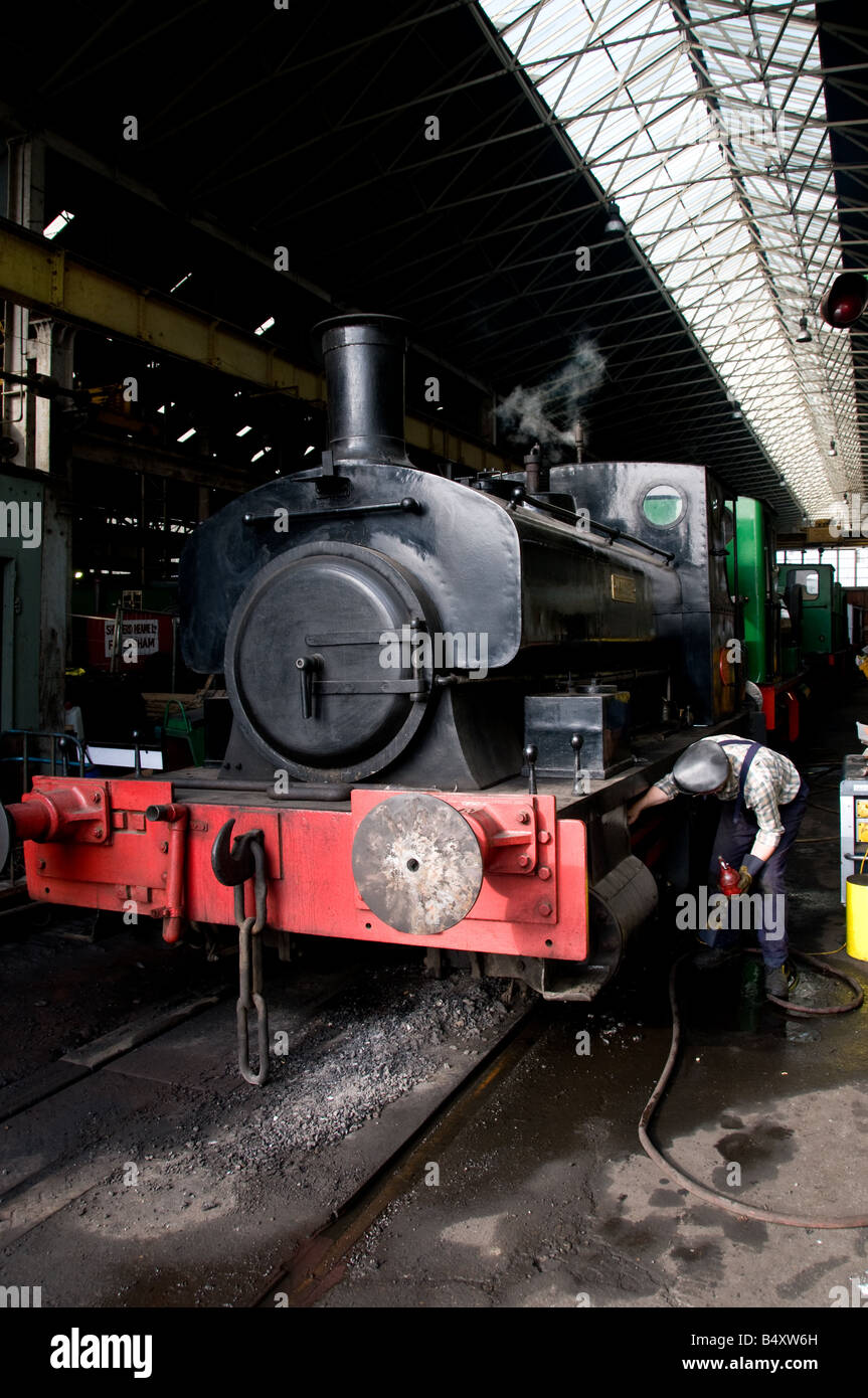 An engineer preparing the Barclay 0 4 0pt saddle tank locomotive Annie at Chatham Historic Dockyard in Kent. Stock Photo