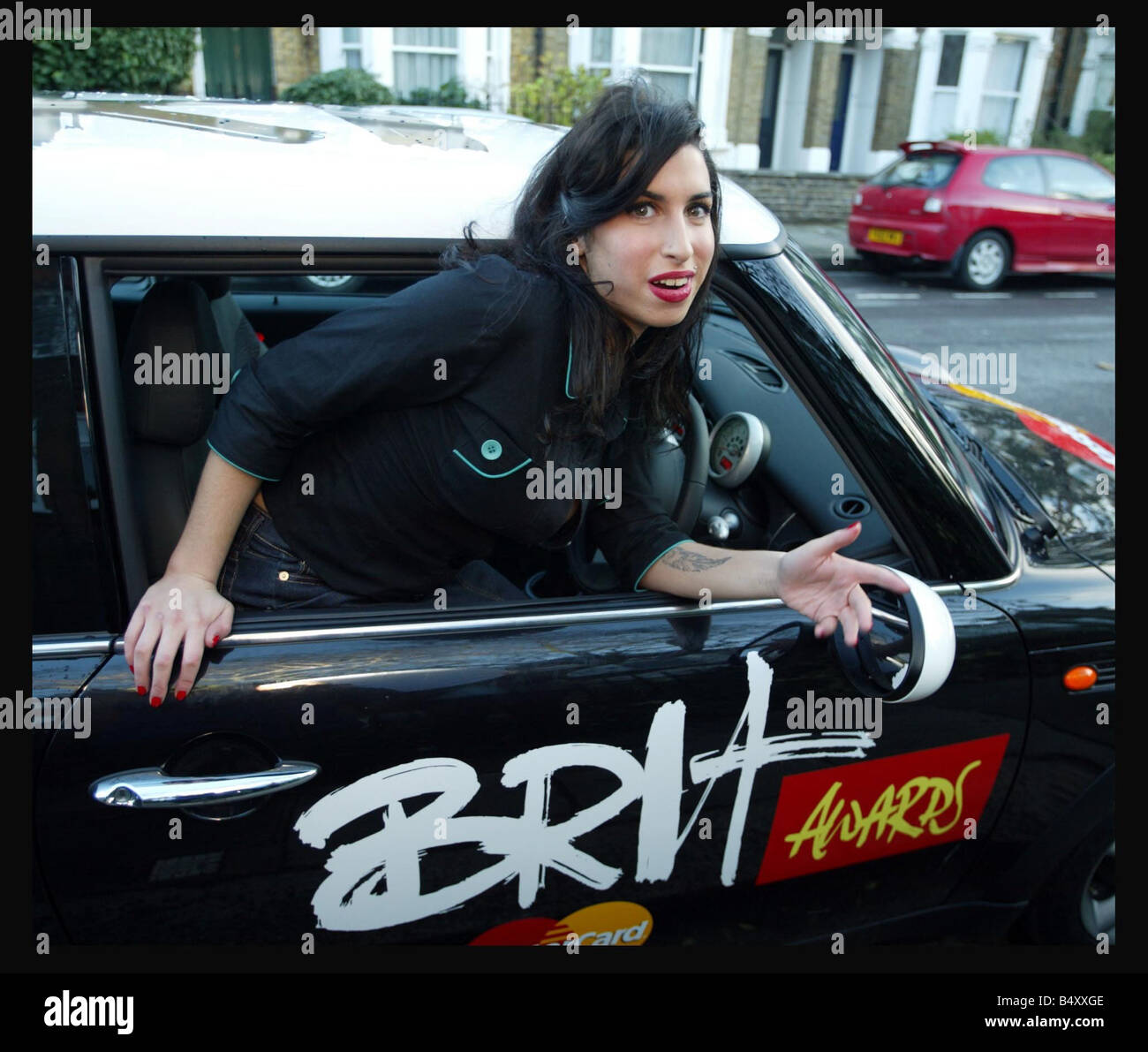 Singer Amy Winehouse poses by a Brits sponsored Mini car January 2004 Amy will appear on the Brit s nominations - Stock Image