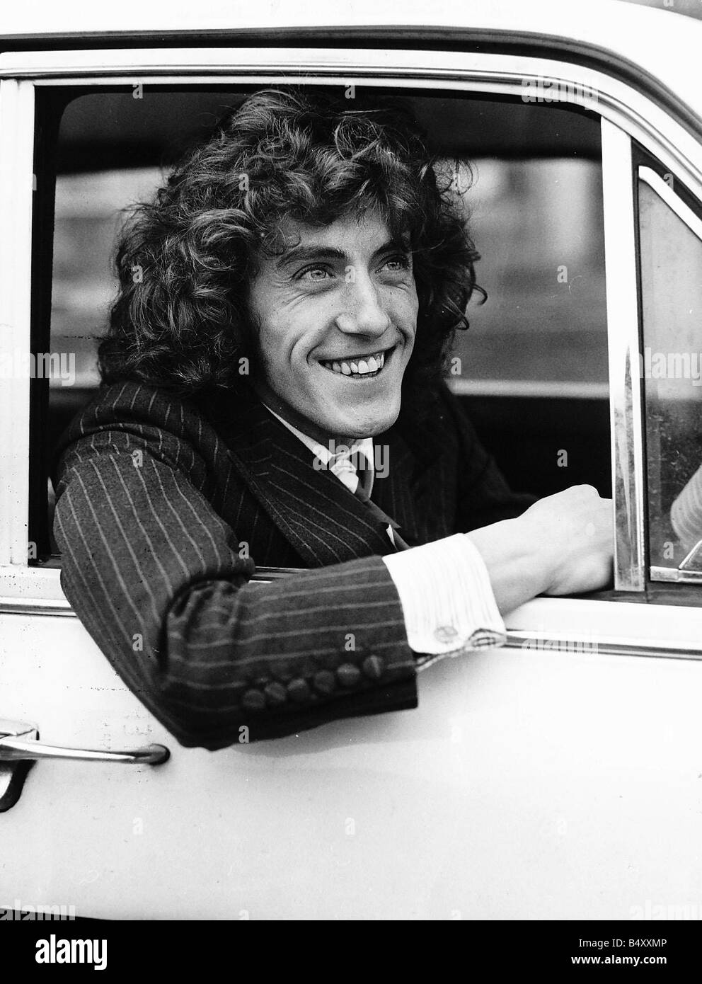 The Who pop group member Roger Daltrey sitting in car - Stock Image