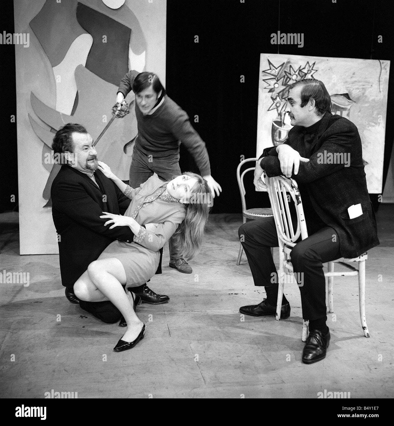 Leo McKern Bearded January 1967 holds Maureen O Brien in back ground Mathew Long Holding Sword looking on is Sean - Stock Image