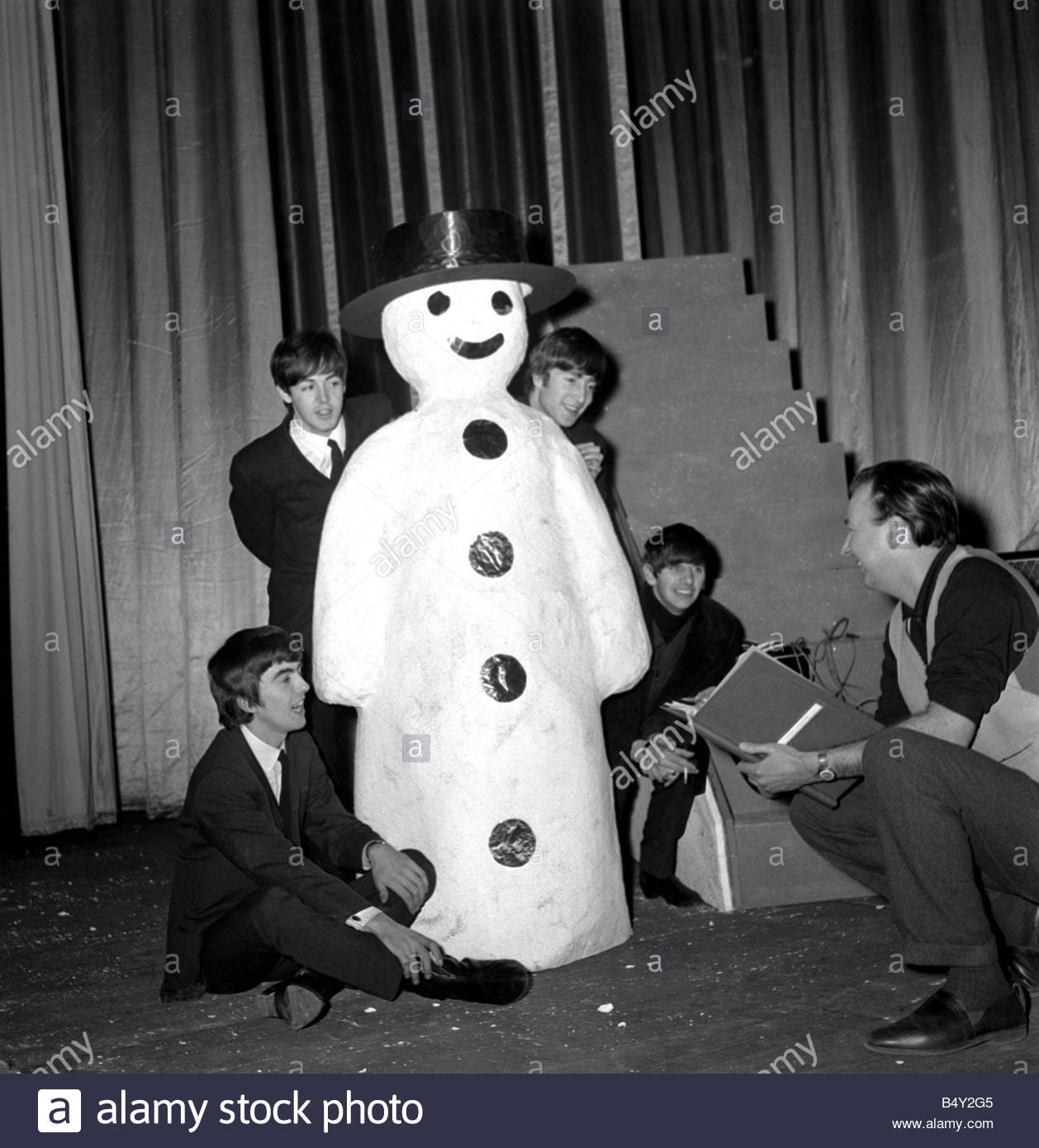 Pop Group The Beatles December 1963 The Beatles meet a snowman at the Finsbury Park Astoria where they are rehearsing - Stock Image