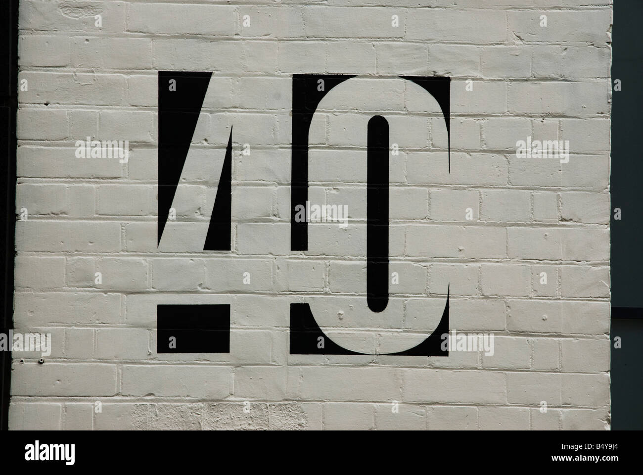 Number 40 painted on a white brick wall - Stock Image