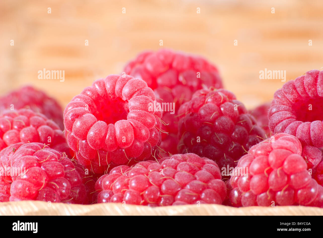The bast basket with a raspberry is photographed a close up - Stock Image