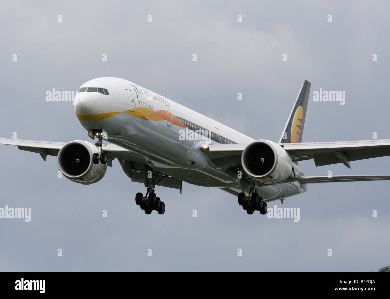 Jet Airways Boeing 777-300ER on approach to Heathrow - Stock Image