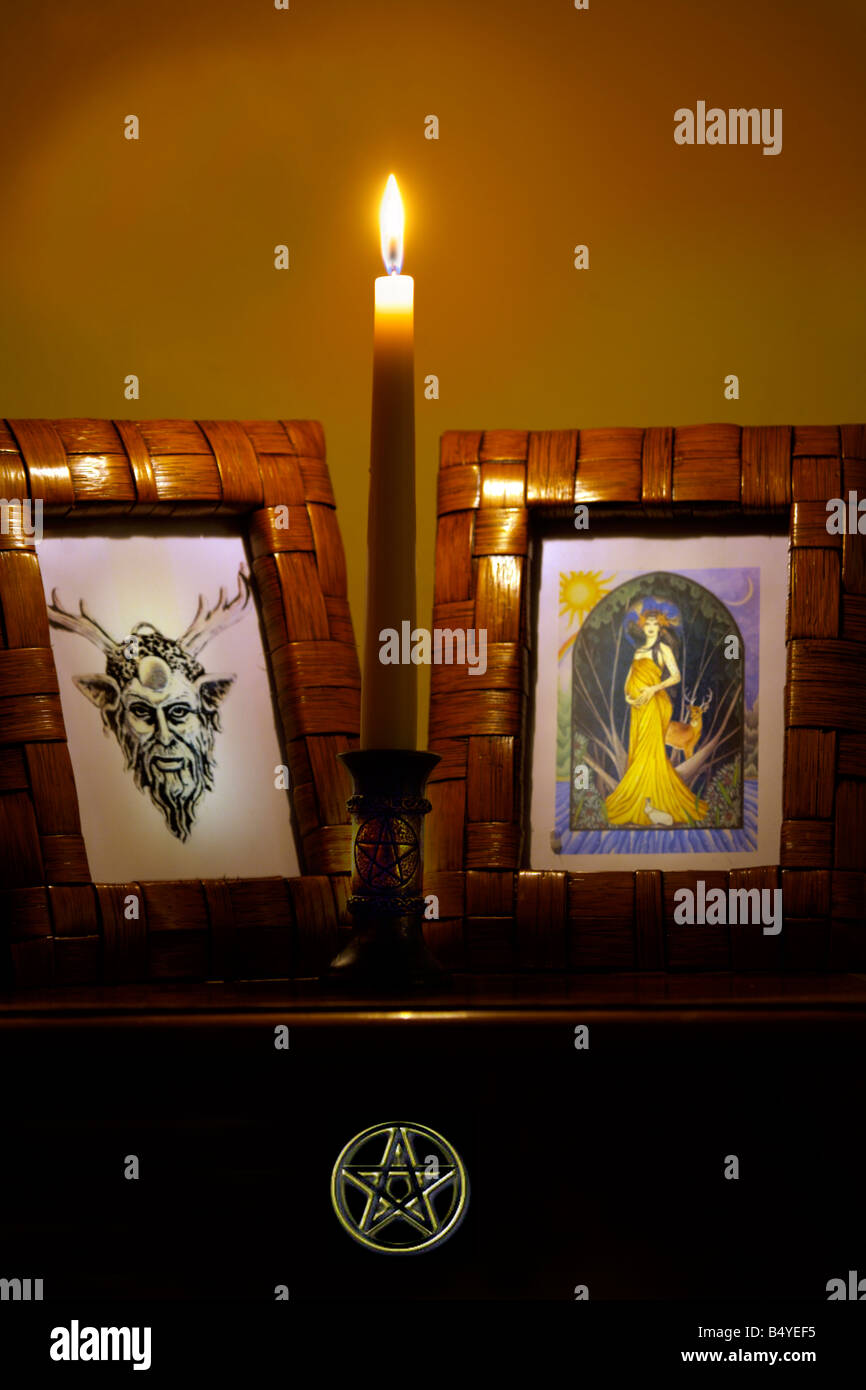 Wiccan Altar with candle god and goddess images and pentagram altar cloth Wicca Pagan Witchcraft old religion religious - Stock Image