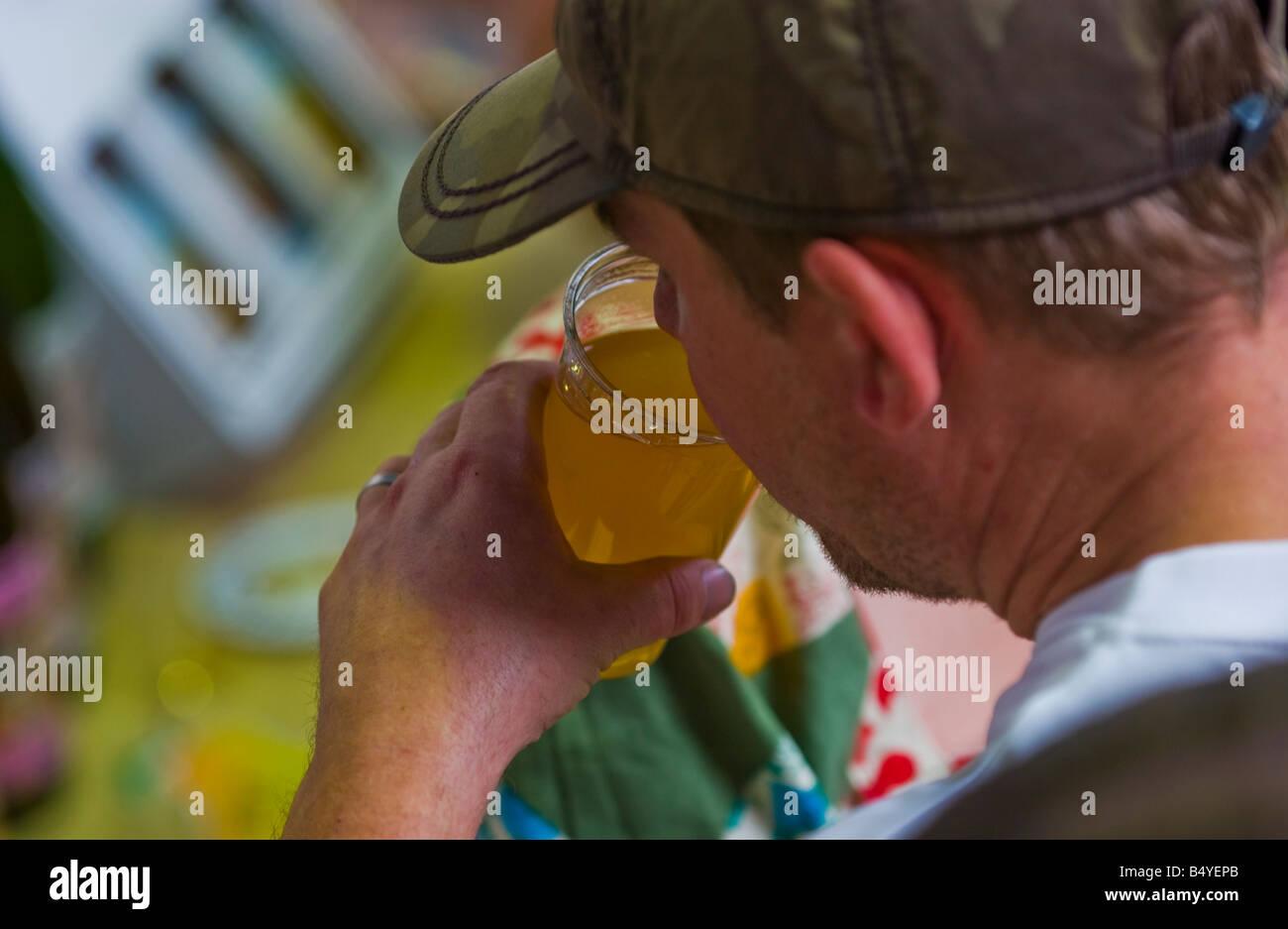Man drinking pint of scrumpy cider at Abergavenny Food Festival - Stock Image