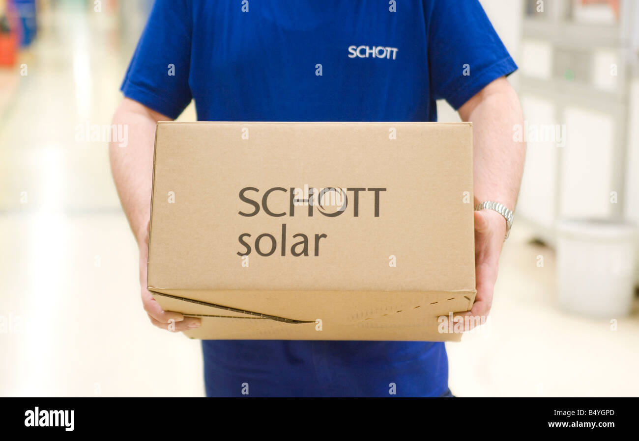 SCHOTT Solar AG production of solar cells Worker with packaged solar cells ready for shipping - Stock Image