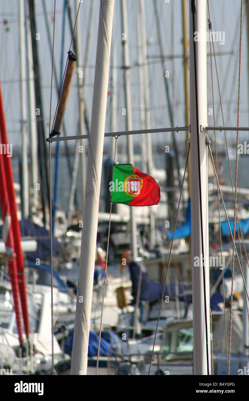 A portugese flag attached to a sailing boat - Stock Image