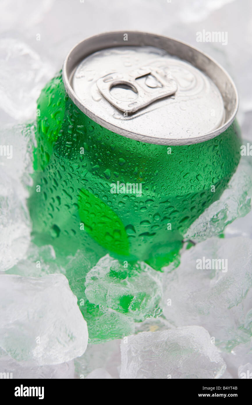 Green Can Of Fizzy Soft Drink Set In Ice - Stock Image