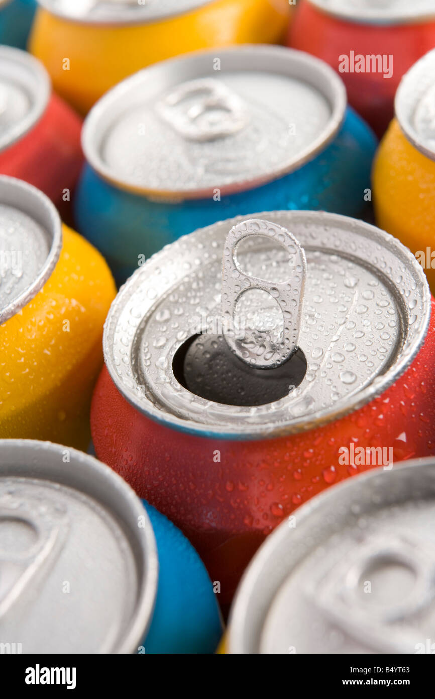 Close Up Of Multi Colored Soda Cans With One Open - Stock Image