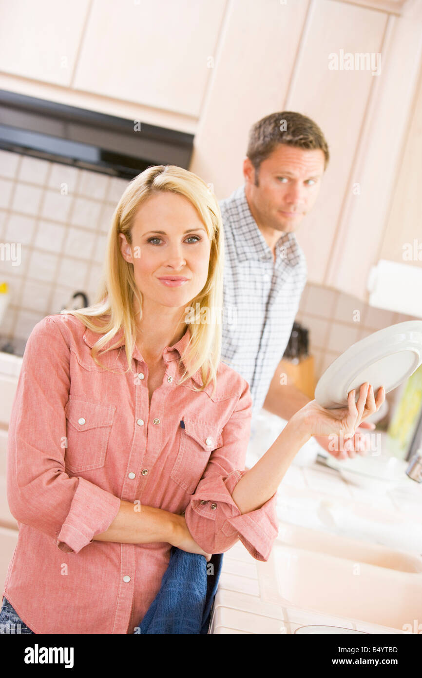 Husband And Wife Doing Dishes - Stock Image