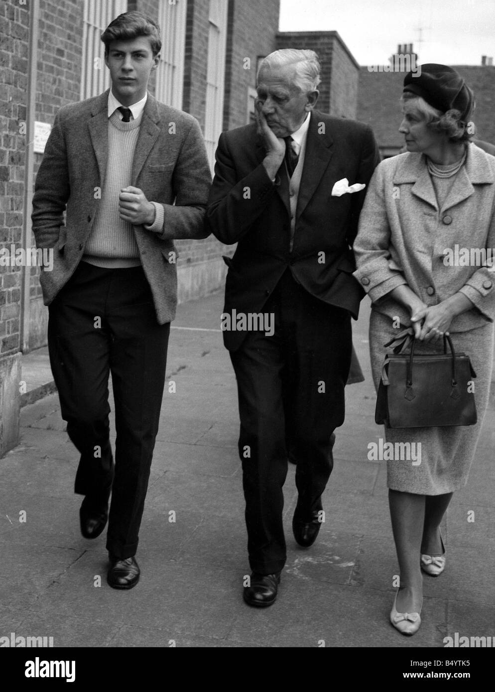 Ranulph Twisleton Wickham Fiennes seen here with his godfather Sir Ernest Gowers and his mother Lady Fiennes leaving Stock Photo
