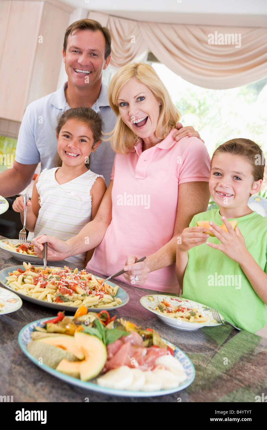 Mother Serving Up Dinner For Family - Stock Image