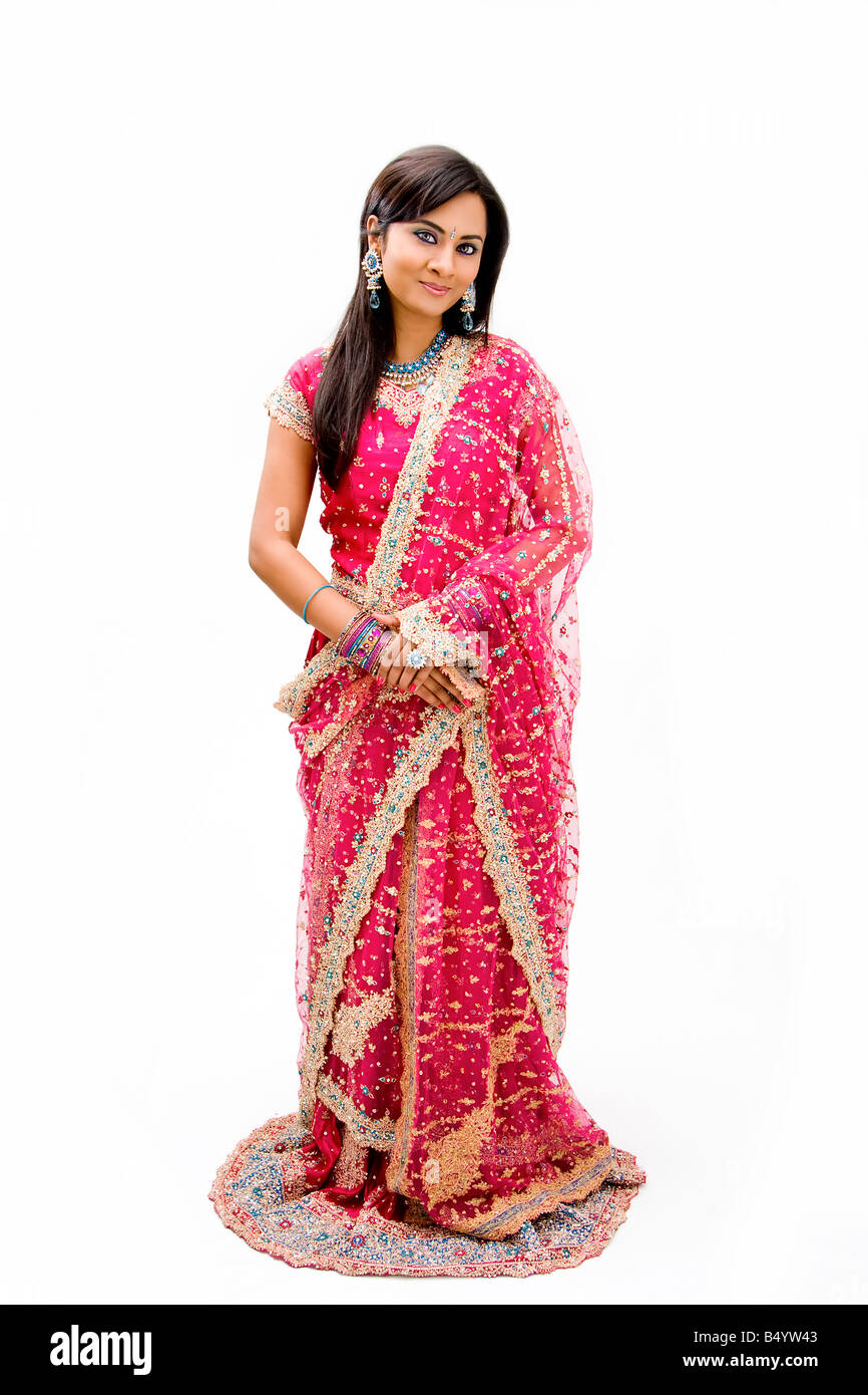 Beautiful Bangali bride in colorful dress standing isolated - Stock Image