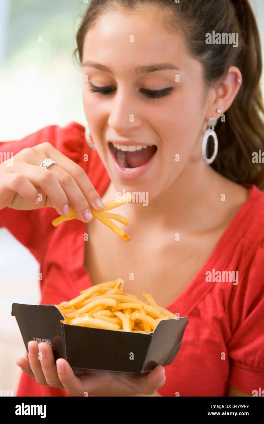 70c18c2c832 Teenage Girl Eating French Fries Stock Photo  20281921 - Alamy